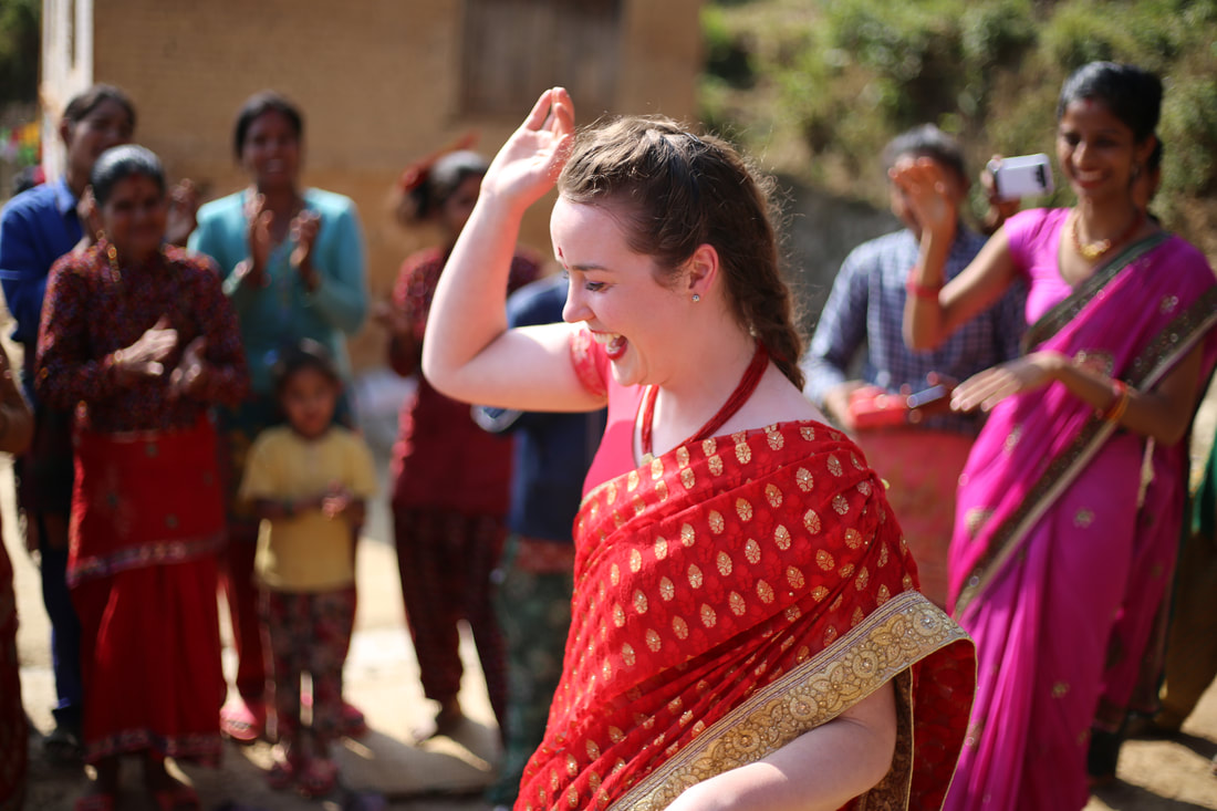 Student dancing in local dress in Nepal.