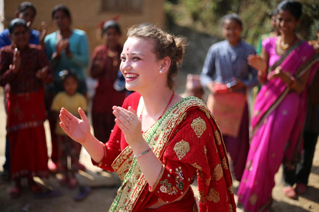 Female student dancing in local costume, Nepal