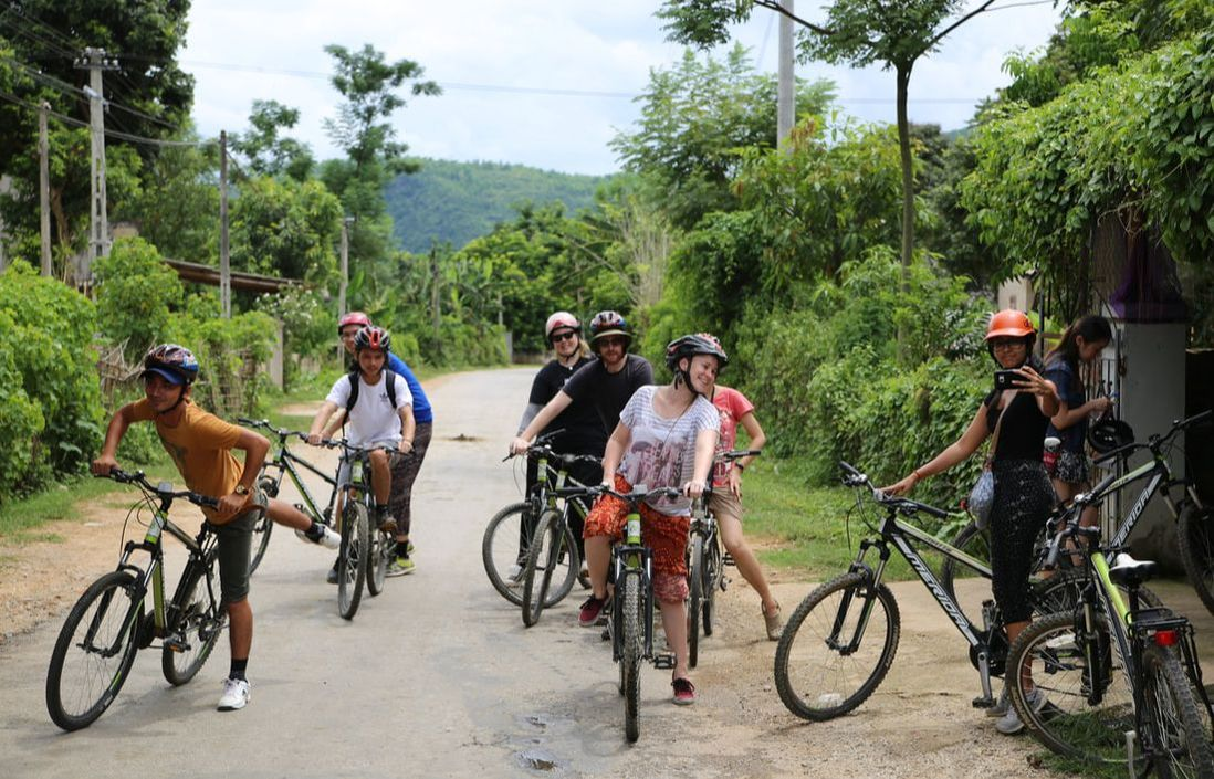 Students riding bicycles in Vietnam.